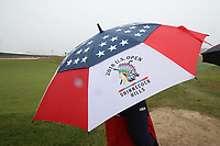 A volunteer watches play on the 10th hole in the rain during the Wednesday practice round of the 118th U.S. Open Championship at Shinnecock Hills Golf Club in Southampton, NY, USA. 13th June 2018.<br /> Picture: Golffile | Brian Spurlock<br /> <br /> <br /> All photo usage must carry mandatory copyright credit (&copy; Golffile | Brian Spurlock)