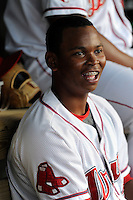 Designated hitter Rafael Devers (13) of the Greenville Drive in a game against the Charleston RiverDogs on Sunday, May 24, 2015, at Fluor Field at the West End in Greenville, South Carolina. Devers is the No. 6 prospect of the Boston Red Sox, according to Baseball America. Charleston won 3-2. (Tom Priddy/Four Seam Images)