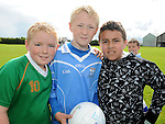 Dylan Seagrave, Jack Murphy and Emran Moustafa who took part in the Kick to Croker event at Newtown Blues GAA club. Photo: Colin Bell/pressphotos.ie