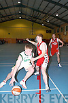 Tommy Walsh (Meadowlands St. Brendans) and Eamon John ODonoghue.(Team Garveys St. Marys) clash during their Southern Conference National.League Basketball tie in Castleisland Community Centre last Thursday.