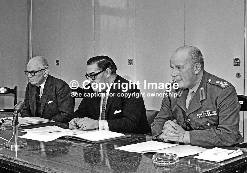 Ivor Richard, MP, Labour Party, UK, Army Minister, centre, announces the formation of the Ulster Defence Regiment, aka UDR, at a January 1970 press conference in N Ireland. The UDR replaced the Ulster Special Constabulary, familiarly known as the B Specials. Also in the photo are General Sir John Anderson, the regiment's first Colonel Commandant, left, and Brigadier Logan Scott-Bowden, the regiment's first regimental commander. 19700101058IR.<br />