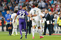 Real Madrid´s Cristiano Ronaldo lamenting and Malaga´s Tighadounini