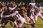 WATERTOWN, CT. 11 October 2019-101119BS395 - Watertown quarterback Xavier Powell (12) finds little running room as he is tackled by Ansonia's Tyler Cafaro #17, left, and Ansonia's Carlos Pinto #47, during a NVL game of the unbeaten between Ansonia and Watertown at Watertown High School on Friday. Bill Shettle Republican-American