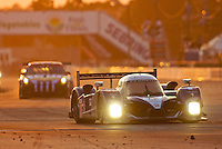 The pole sitting #07 Peugeot 908 HDI FAP of Marc Gene, Alexander Wurz, and Anthony Davidson races down a straightaway at dusk during the 12 Hours of Sebring, Sebring, FL, MArch 20, 2010.  (Photo by Brian Cleary/www.bcpix.com)