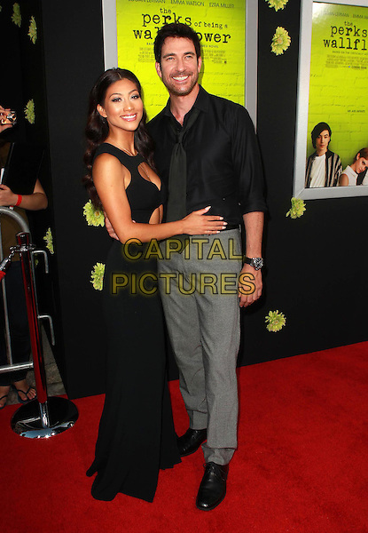"Shasi Wells, Dylan McDermott.Premiere Of Summit Entertainment's ""The Perks Of Being A Wallflower"" Held At ArcLight Cinemas, Hollywood, California, USA..September 10th, 2012.full length dress shirt grey gray trousers tie couple black .CAP/ADM/KB.©Kevan Brooks/AdMedia/Capital Pictures."