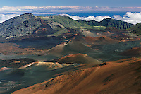 Multi colored cinder cones and lava flows dot the landscape of the crater in HALEAKALA NATIONAL PARK on Maui in Hawaii