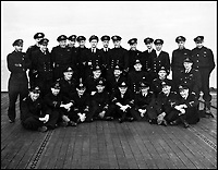 BNPS.co.uk (01202 558833)Pic: CharterhouseAuctioneers/BNPS<br /> <br /> The Royal Naval officers onboard HMS Fencer.<br /> <br /> A remarkable wartime photo album that highlights the perilous nature of landing a fighter plane on an aircraft carrier in heavy seas has been unearthed.<br /> <br /> The black and white snaps show several Royal Naval aircraft coming a cropper while attempting to land on board HMS Fencer often in heavy seas.<br /> <br /> One set of images depict a Swordfish biplane crashing into the sea a few hundred yards off the aircraft carrier HMS Fencer.<br /> <br /> Other photos show a Supermarine Seafire about the crash into the superstructure.<br /> <br /> The album will be sold by Charterhouse Auctioneers in Sherborne, Dorset.