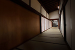 Traditional Japanese interior, corridor with tatami mats on the floors and shoji sliding screens in a Buddhist temple in Kyoto, Japan