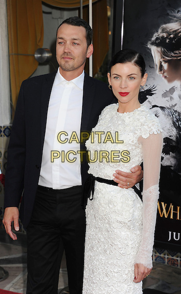 "Rupert Sanders, Liberty Ross.The Los Angeles Screening of ""Snow White And The Huntsman"" at Westwood Village Theatre in Westwood, California, USA..May 29th, 2012 .half length dress suit shirt arm around waist red lipstick white lace  .CAP/ROT/TM.©Tony Michaels/Roth Stock/Capital Pictures"