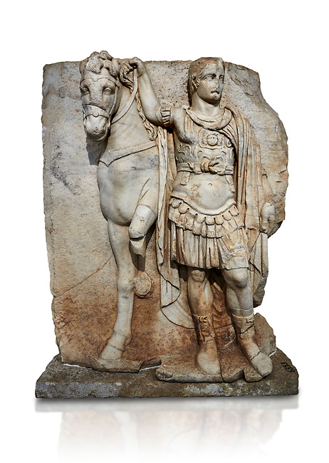 Roman Sebasteion relief sculpture of  an Imperial prince as Diokouros, Aphrodisias Museum, Aphrodisias, Turkey.   Against a white background.<br /> <br /> An imperial youth wearing a military cloak and cuirass of a commander holds the reins of hios horse. This panel is next to a Claudius panel so is probably of Britanicus or Nero the emperors son and intended successor
