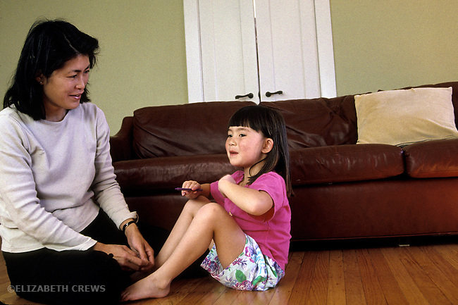 Berkeley CA Mother and daughter, four-years-old, playfully talking together
