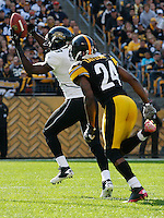 PITTSBURGH, PA - OCTOBER 16:  Jason Hill #83 of the Jacksonville Jaguars catches a touchdown pass in front of Ike Taylor #24 of the Pittsburgh Steelers during the game on October 16, 2011 at Heinz Field in Pittsburgh, Pennsylvania.  (Photo by Jared Wickerham/Getty Images)