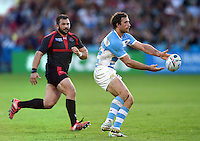 Marcelo Bosch of Argentina passes the ball. Rugby World Cup Pool C match between Argentina and Georgia on September 25, 2015 at Kingsholm Stadium in Gloucester, England. Photo by: Patrick Khachfe / Onside Images