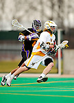 10 April 2011: University of Vermont Catamount attacker A.J. Masson, a Sophomore from Newmarket, Ontario, in action against the University at Albany Great Danes on Moulton Winder Field in Burlington, Vermont. The Catamounts defeated the visiting Danes 11-6 in America East play. Mandatory Credit: Ed Wolfstein Photo