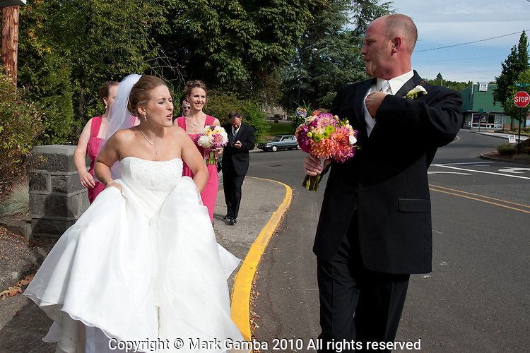Ryan Smith and Laura Champion being married in Oregon City.