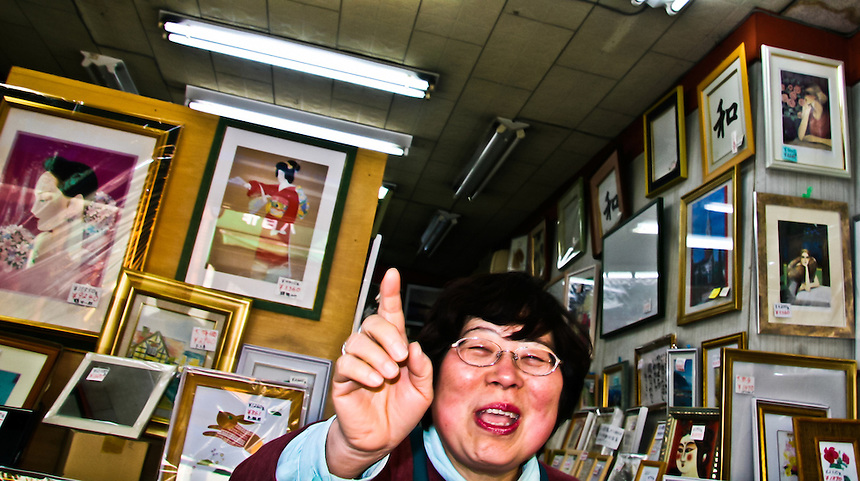 Japanese Picture frame shop owner who does n`t like having her photo taken.