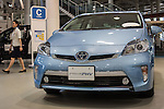 November 5, 2014, Tokyo, Japan - (FILE PHOTO) A file photo shows a staff member walking past a Toyota Prius PHV at the Toyota Motor Corporation showroom in Tokyo, Japan on August 5, 2014. Toyota posted its operating income of 1.3519 trillion yen in which the company revised its forecast to 2.50 trillion yen from 2.30 trillion yen. (Photo by AFLO)