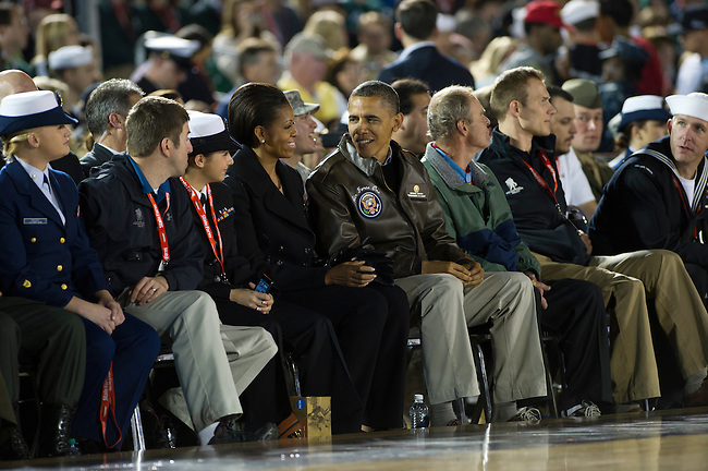 SAN DIEGO, CA - NOVEMBER 11, 2011: (L to R) First Lady of the United States Michelle Obama and Barack Obama the 44th President of the United States watching the Michigan State Spartans and the North Carolina Tar Heels during the 2011 Quicken Loans Carrier Classic on the USS Carl Vinson..(Photo by Robert Beck / ESPN)..- RAW FILE AVAILABLE -.- CMI000165220.jpg -
