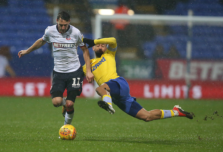 Bolton Wanderers' Will Buckley is tackled by Leeds United's Kemar Roofe<br /> <br /> Photographer Stephen White/CameraSport<br /> <br /> The EFL Sky Bet Championship - Bolton Wanderers v Leeds United - Saturday 15th December 2018 - University of Bolton Stadium - Bolton<br /> <br /> World Copyright © 2018 CameraSport. All rights reserved. 43 Linden Ave. Countesthorpe. Leicester. England. LE8 5PG - Tel: +44 (0) 116 277 4147 - admin@camerasport.com - www.camerasport.com