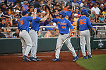 OMAHA, NE - JUNE 26: Austin Langworthy (44) of the University of Florida is greeted by his teammates after scoring a run against Louisiana State University during the Division I Men's Baseball Championship held at TD Ameritrade Park on June 26, 2017 in Omaha, Nebraska. The University of Florida defeated Louisiana State University 4-3 in game one of the best of three series. (Photo by Jamie Schwaberow/NCAA Photos via Getty Images)