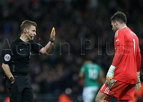 25th November 2017, Wembley Stadium, London England; EPL Premier League football, Tottenham Hotspur versus West Bromwich Albion; Referee Michael Jones gives a Yellow card to Goalkeeper Ben Foster of West Bromwich Albion for time wasting
