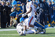Annapolis, MD - DEC 28, 2017: Navy Midshipmen running back Josh Brown (28) hurdles a pile of Virginia Cavaliers defenders on his way to a first down during game between Virginia and Navy at the Military Bowl presented by Northrop Grunman at Navy-Marine Corps Memorial Stadium Annapolis, MD. (Photo by Phil Peters/Media Images International)