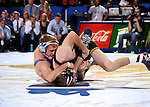 BROOKINGS, SD - DECEMBER 2:  Alex Kocer from SDSU battles with Brandon Sorenson from Iowa in their 149 pound match Friday night at Frost Arena in Brookings, SD.(Photo by Dave Eggen/Inertia)