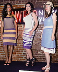 Models pose in outfits from the Jia collection by Jia Li, during the inaugural Wear New York Fashion Week presentation at 393 Broadway on June 27, 2013.
