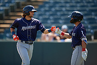Binghamton Rumble Ponies Gavin Cecchini (left) fist bumps Michael Paez (7) after hitting a home run during an Eastern League game against the Bowie Baysox on August 21, 2019 at Prince George's Stadium in Bowie, Maryland.  Bowie defeated Binghamton 7-6 in ten innings.  (Mike Janes/Four Seam Images)