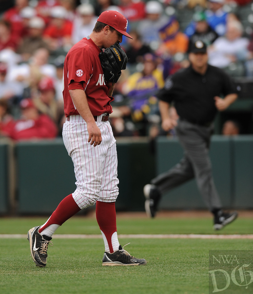 NWA Democrat-Gazette/ANDY SHUPE - Closer Jacob Stone of Arkansas watches as a 2-run home run hit by Conner Hale of LSU sails over the wall in right during the ninth inning Saturday, March 21, 2015, at Baum Stadium in Fayetteville. Visit nwadg.com/photos for more photos from the game.