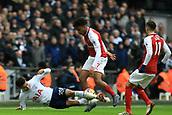10th February 2018, Wembley Stadium, London England; EPL Premier League football, Tottenham Hotspur versus Arsenal; Alex Iwobi of Arsenal fouls Dele Alli of Tottenham Hotspur