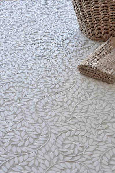 Jacqueline Vine, a natural stone waterjet mosaic shown in tumbled Thassos, is part of the Silk Road Collection by Sara Baldwin for New Ravenna Mosaics. Take the next step: prices, samples and design help, http://www.newravenna.com/showrooms/
