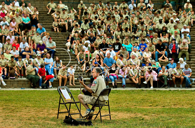 A leader entertains parents before an Order of the Arrow ceremony at Camp Raven Knob Scout Reservation, one of the largest Boy Scout camps in the United States. Camp Raven Knob is located within Boy Scouts of America's Old Hickory Council in Mt. Airy, North Carolina. Order of the Arrow is BSA's national honor society. Using American Indian-styled traditions and ceremonies, Order of the Arrow bestow recognition on exemplary Scouts.