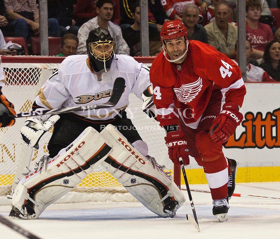 8 October 2010: Anaheim Ducks goalie Jonas Hiller (1) pushes on Detroit Red Wings forward Todd Bertuzzi (44) to keep him out of the crease, in the second period of the Anaheim Ducks at Detroit Red Wings NHL hockey game, at Joe Louis Arena, in Detroit, MI...***** Editorial Use Only *****