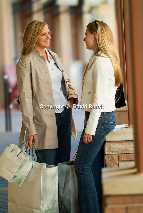 Mother and daughter, shopping and talking