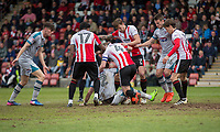 Ben Davies of Grimsby and Kyle Storer of Cheltenham Town in the middle of a scramble for the ball during the Sky Bet League 2 match between Cheltenham Town and Grimsby Town at the The LCI Rail Stadium,  Cheltenham, England on 17 April 2017. Photo by PRiME Media Images / Mark Hawkins.