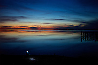Sunset at the Frigorifico slaughterhouse beach where the locals gather to fish.  (Slaughterhouse) Anglo, Fray Bentos, Rio Negro, Uruguay.  ..Atardecer en la playa del frigorífico donde los locales se congregan a pescar.  Frigorifico Anglo, Fray Bentos, Río Negro, Uruguay.