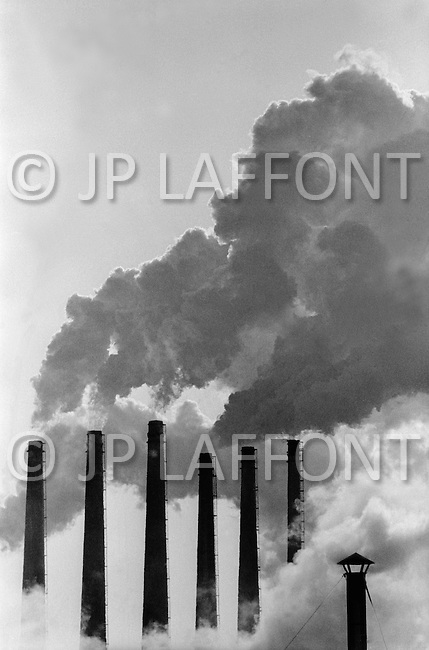 Lansing, MI, March 1973.<br /> Pollution coming from G.M. Oldsmobile Factory.
