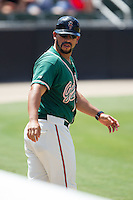 Greensboro Grasshoppers player/coach Jose Ceballos (10) during the game against the Kannapolis Intimidators at CMC-NorthEast Stadium on September 1, 2014 in Kannapolis, North Carolina.  The Grasshoppers defeated the Intimidators 7-4.  (Brian Westerholt/Four Seam Images)