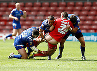 Photo: Richard Lane/Richard Lane Photography. Crusaders v Hull KR. Engage Super League. 09/07/2011. Crusaders' Joe Burton is tackled by KR's Ben Galea, Josh Hodgson and Scott Murrell.