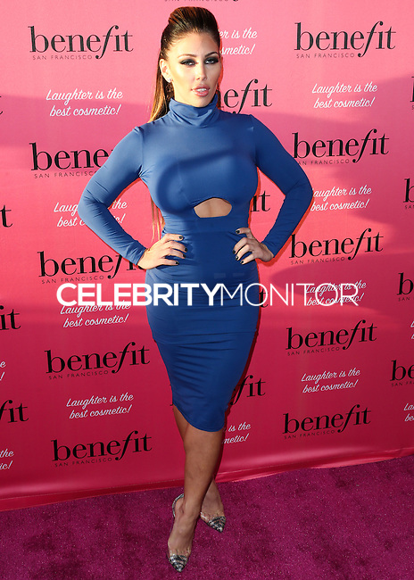 HOLLYWOOD, LOS ANGELES, CA, USA - SEPTEMBER 26: Carmen Ortega arrives at the Benefit Cosmetics: Wing Woman Weekend Kick-Off Party held at the Benefit Tattoo Parlor on September 26, 2014 in Hollywood, Los Angeles, California, United States. (Photo by Xavier Collin/Celebrity Monitor)