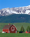 Wallowa County, OR   <br /> The red &quot;OK Quarter Circle barn&quot; near Joseph with the snow capped Wallowa range in the distance