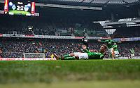 FUSSBALL   1. BUNDESLIGA   SAISON 2012/2013    26. SPIELTAG SV Werder Bremen - Greuther Fuerth                        16.03.2013 Marko Arnautovic (SV Werder Bremen) liegt enttaeuscht am Boden. Im Hintergrund zeigt die Anzeigentafel das Endergebnis 2:2 an