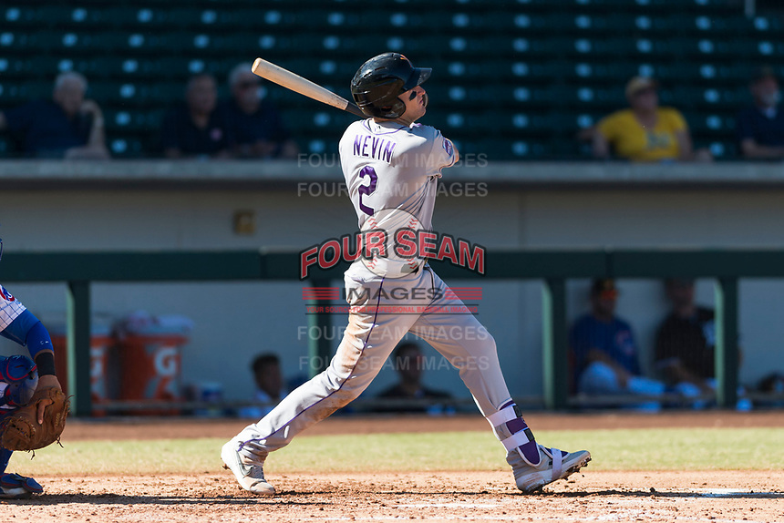 Salt River Rafters first baseman Tyler Nevin (2), of the Colorado Rockies organization, follows through on his swing during an Arizona Fall League game against the Mesa Solar Sox at Sloan Park on October 30, 2018 in Mesa, Arizona. Salt River defeated Mesa 14-4 . (Zachary Lucy/Four Seam Images)