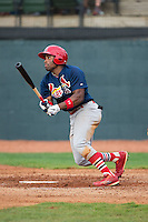 Malik Collymore (15) of the Johnson City Cardinals follows through on his swing against the Bristol Pirates at Boyce Cox Field on July 7, 2015 in Bristol, Virginia.  The Cardinals defeated the Pirates 4-1 in game one of a double-header. (Brian Westerholt/Four Seam Images)