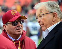 Washington Redskins owner Daniel M. Snyder, left and former Redskins head coach Joe Gibbs confer on the field prior to the game against the Philadelphia Eagles at FedEx Field in Landover, Maryland on December 30, 2018.  The Eagles won the game 24 - 0. Photo Credit: Ron Sachs/CNP/AdMedia