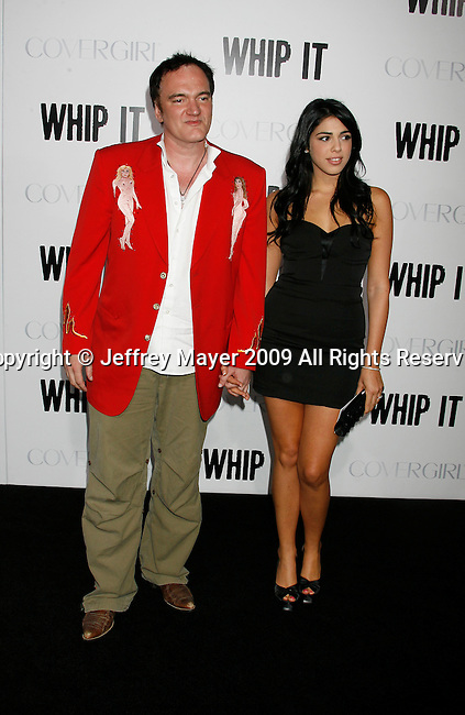"""HOLLYWOOD, CA. - September 29: Quentin Tarantino and Daniella Pick arrive at the Los Angeles premiere of """"Whip It"""" at the Grauman's Chinese Theatre on September 29, 2009 in Hollywood, California."""