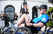 United States President Barack Obama cheers on bicyclists from the Wounded Warrior Project's Soldier Ride as they ride around the South Lawn of the White House in Washington, DC, April 20, 2012. Soldier Ride provides rehabilitation opportunities for US military members wounded during the wars in Iraq and Afghanistan, raising public awareness of the challenges facing veterans as they recover from life-altering injuries. .Credit: Olivier Douliery / Pool via CNP