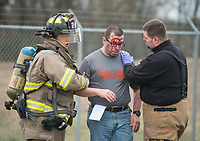 NWA Democrat-Gazette/BEN GOFF @NWABENGOFF<br /> First responders tend to simulated victims Friday, March, 23, 2018, during disaster training at Northwest Arkansas Regional Airport in Highfill. Multiple Northwest Arkansas emergency agencies participated in the training, with volunteers acting as victims to create a simulated aircraft emergency. The airport holds the large-scale, multi-agency drills every three years according to Gilbert Neil, the airport's public safety director.