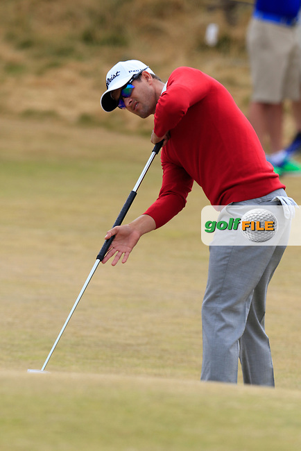Adam Scott (AUS) putts onto the 17th green during Thursday's Round 1 of the 2015 U.S. Open 115th National Championship held at Chambers Bay, Seattle, Washington, USA. 6/18/2015.<br /> Picture: Golffile | Eoin Clarke<br /> <br /> <br /> <br /> <br /> All photo usage must carry mandatory copyright credit (&copy; Golffile | Eoin Clarke)